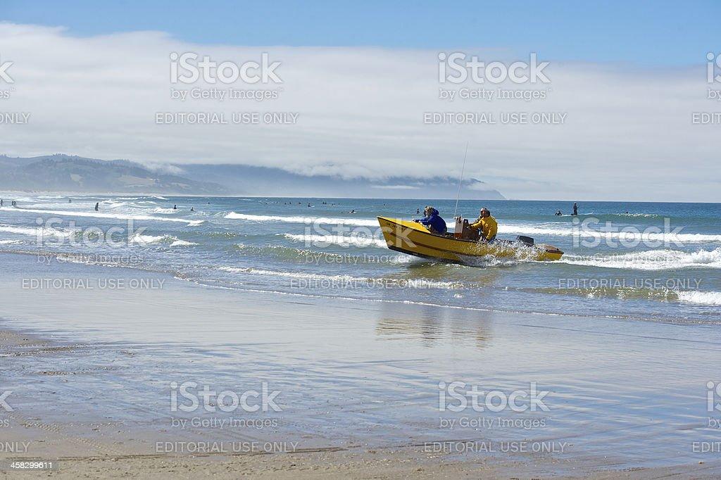 Dory Boat Returning Surf Cape Kiwanda Pacific City Oregon Surfers royalty-free stock photo