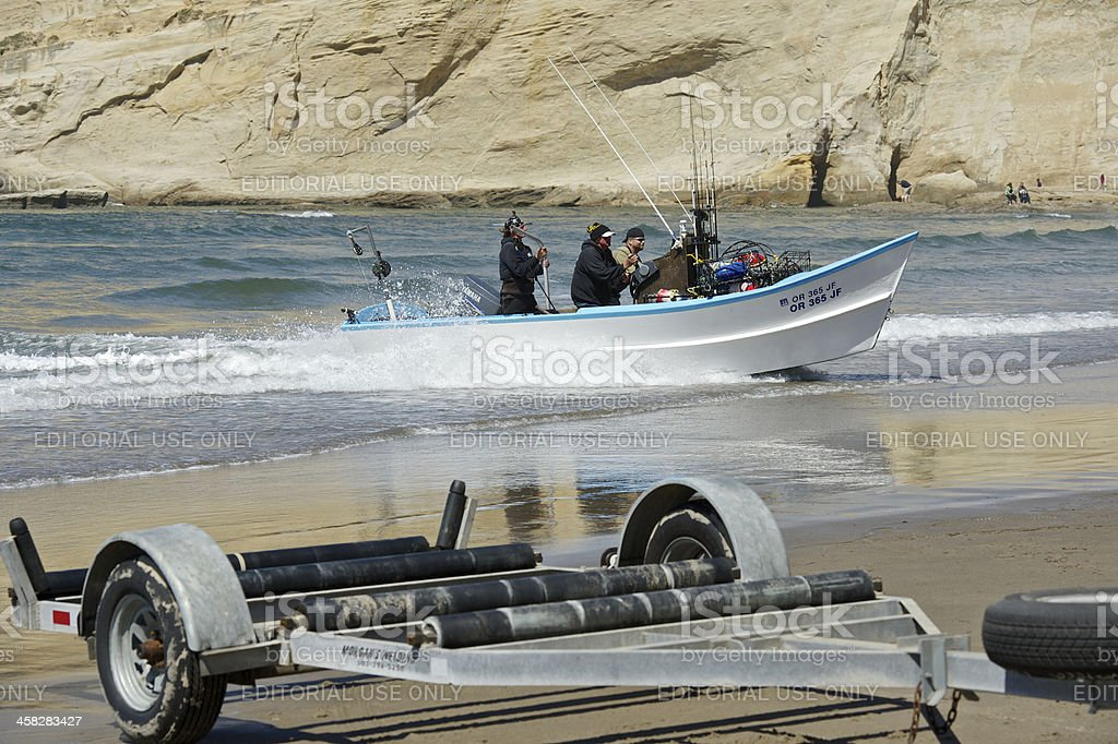 Dory Boat Trailer Surf Returning Cape Kiwanda Pacific City Oregon royalty-free stock photo