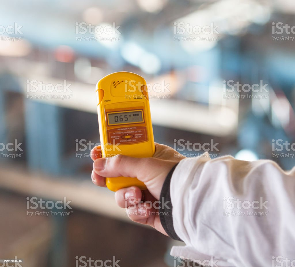 Dosimeter measuring the radiation level stock photo