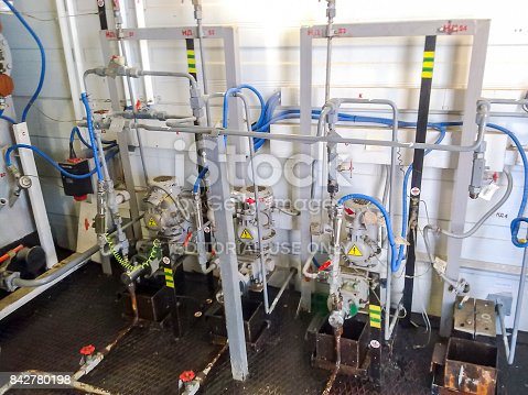 Russia, Nefteyugansk - January 24, 2016: Dosing pumps in reagent block. Chemicals are fed into the system to better delaminate the oil and water emulsion