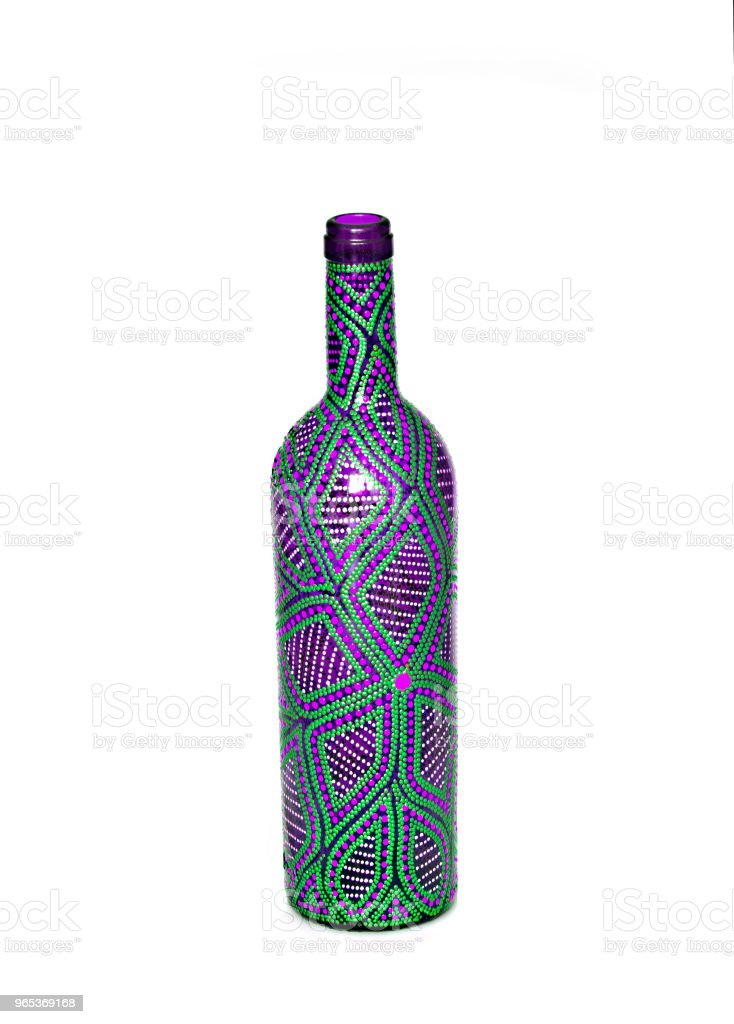 dot painting. bottle painted with paints. very nice decor. isolate. royalty-free stock photo