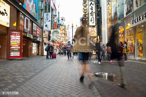 Osaka,Japan - April 21,2015 : Many tourists visit Dotonbori area on April 21,2015 in Osaka,Japan. It is one of the tourist destinations in Osaka, Japan. It is a single street, running alongside the Dotonbori canal.
