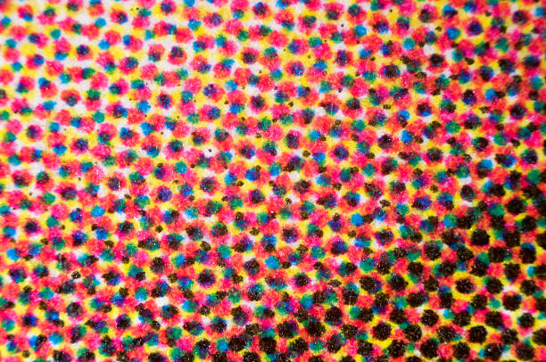 CMYK dots of four-color printing micrograph Photomicrograph of four-color printing. Individual dots of cyan, magenta, yellow, and black are visible. Dry mount, 2.5X objective, reflected illumination. cmyk stock pictures, royalty-free photos & images