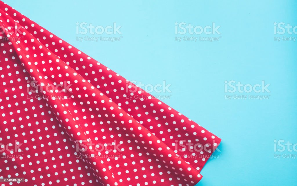 Dots red fabric cloth with blue background.For decoration key visual stock photo