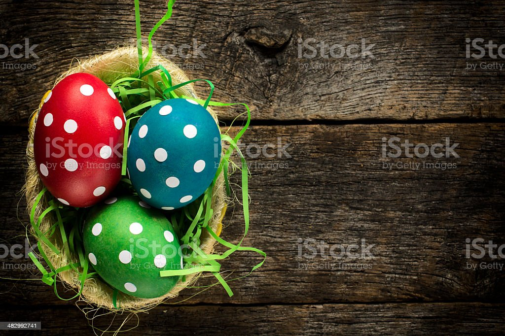 Dotted easter egg in basket stock photo
