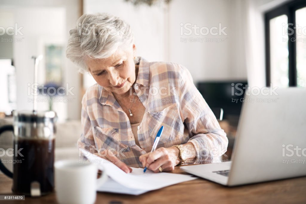 Dotting every I and crossing every T stock photo
