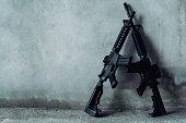 istock Double assault rifle on gray background, terrorist,robber concept. 897870864