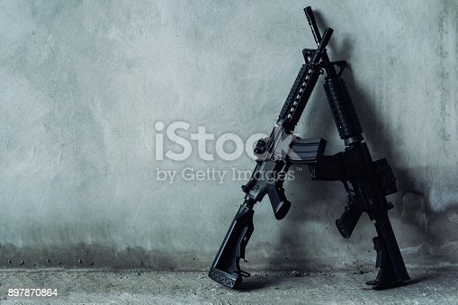 istock Double assault rifle on gray background, terrorist,robber concept. 897870864