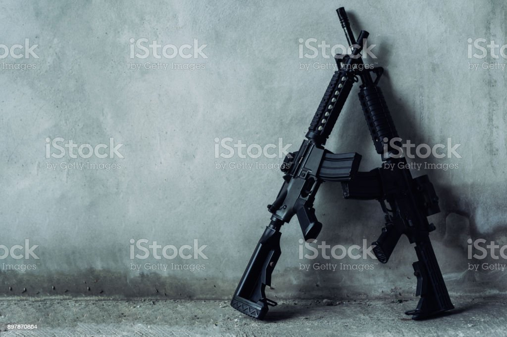 Double assault rifle on gray background, terrorist,robber concept. stock photo