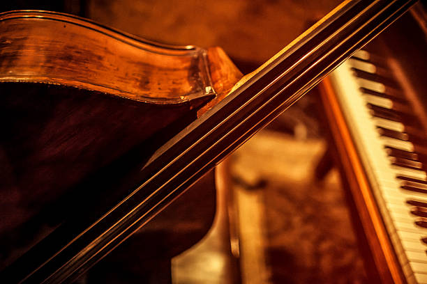 Double bass and piano stock photo