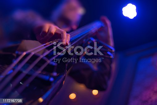 man playing double bass at a concert