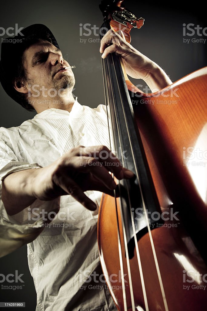 Double bass player royalty-free stock photo