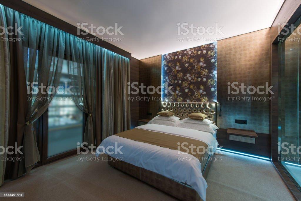 Double Bed And Big Window In Hotel Bedroom Interior stock photo | iStock