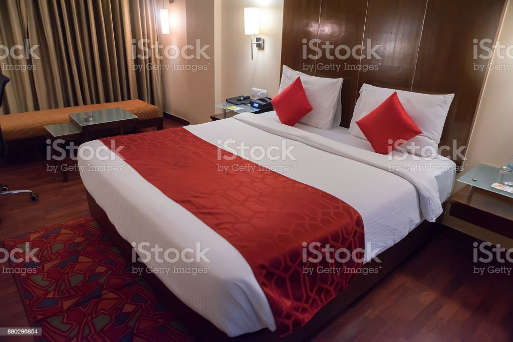 Double bed in a hotel room close up stock photo
