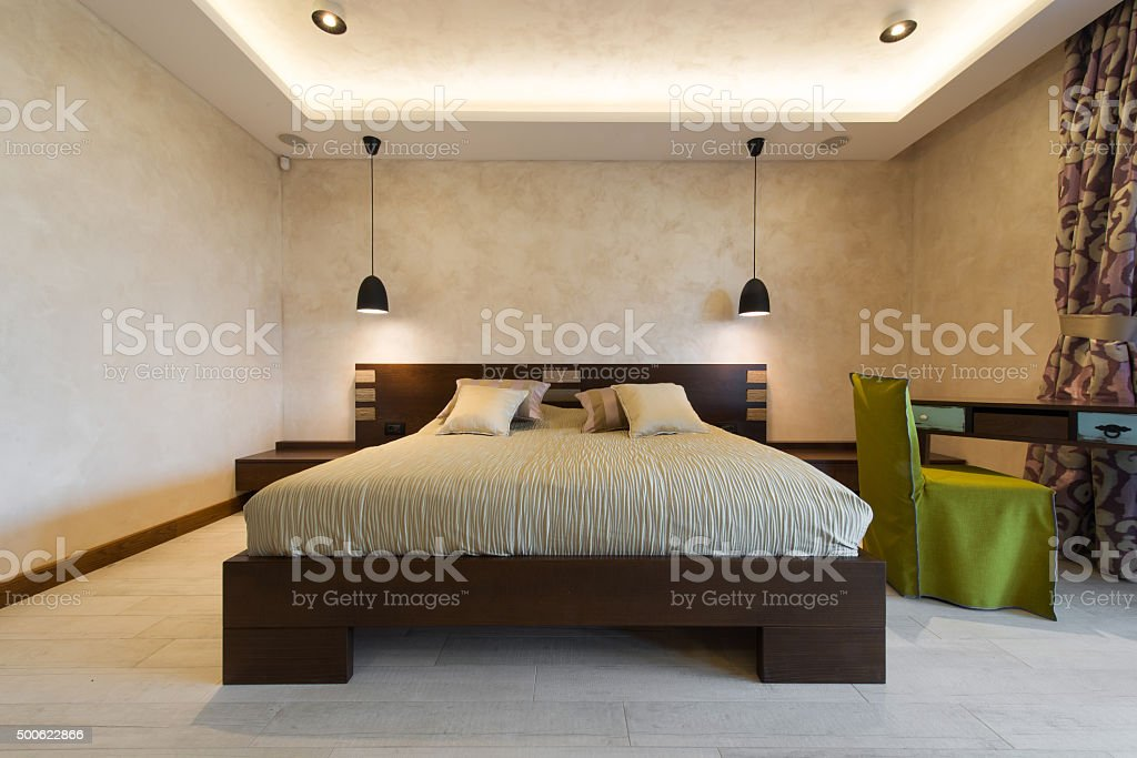Double bed in bedroom interior stock photo