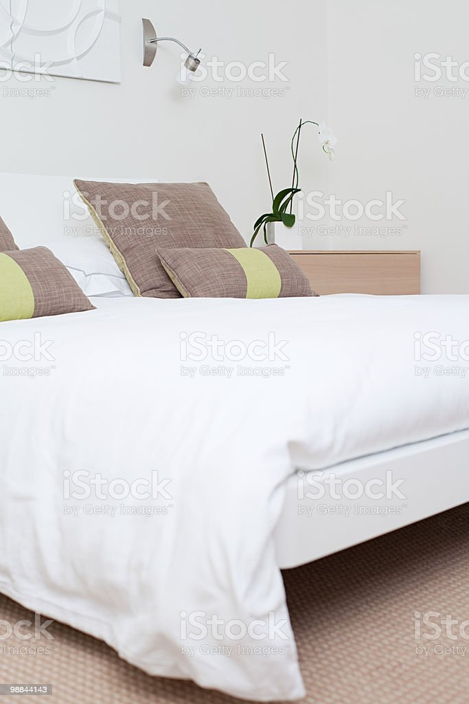 Double bed in bedroom royalty-free stock photo