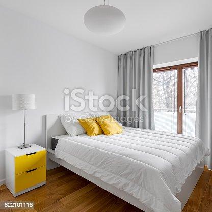 istock Double bed in home bedroom 822101118