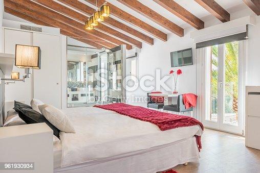 istock Double bed in luxury hotel 961930934