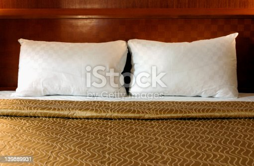 Double bed in hotel room.