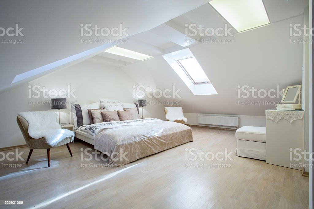 Double bed with a lot of cushions stock photo