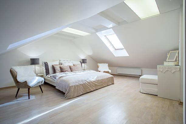 double bed with a lot of cushions - loft apartment stock pictures, royalty-free photos & images