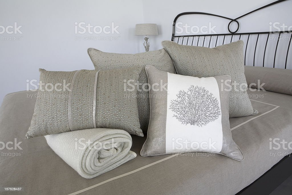 Double Bed with luxurious cushions. royalty-free stock photo