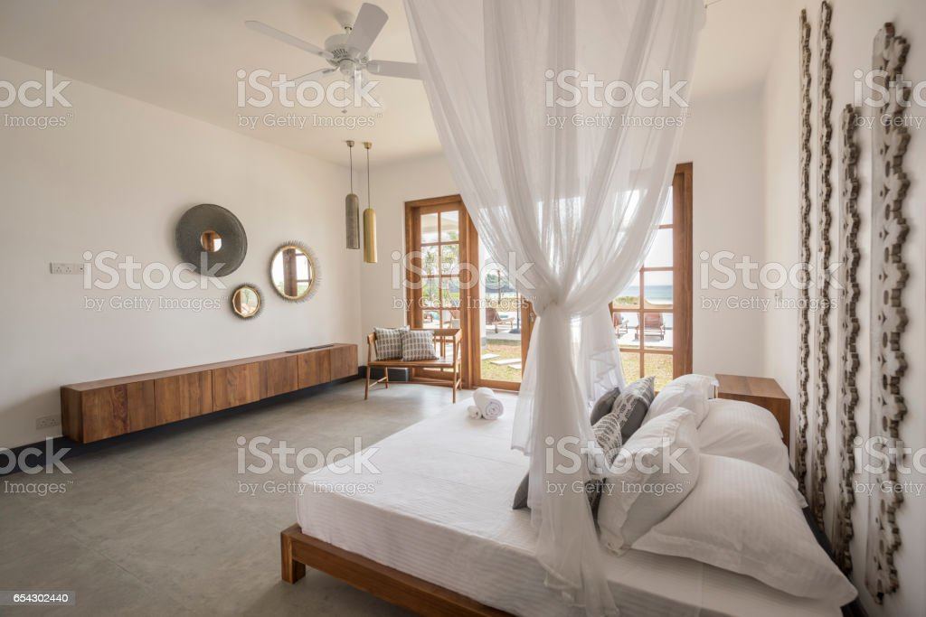 Double Bed With Mosquito Net And Contemporary Furniture Royalty Free Stock  Photo