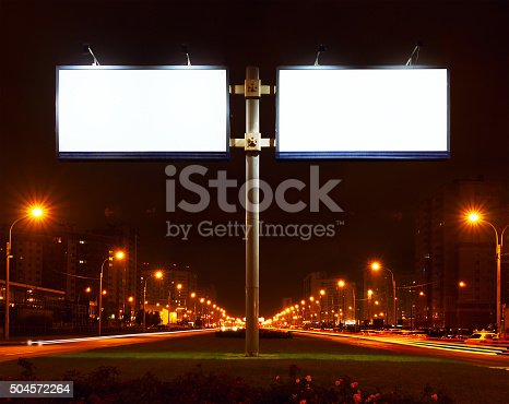 158172107 istock photo Double big white bill-board on lighting street at night 504572264