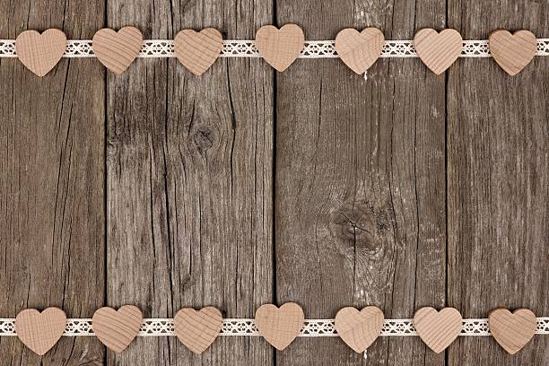 double border of wooden hearts and ribbon lace over  wood - vintage spitze stock-fotos und bilder
