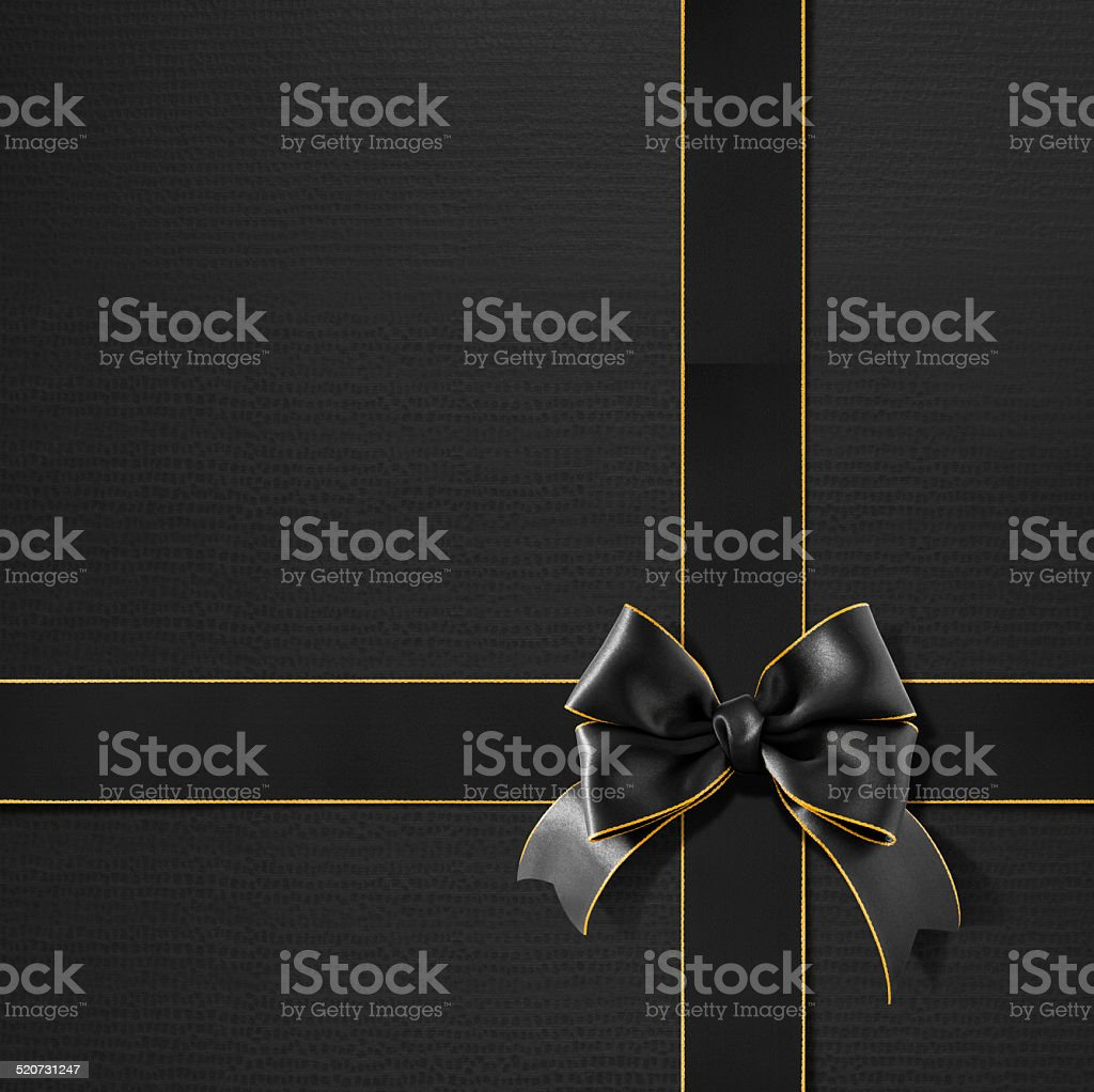 Double bow gold rimmed black ribbon on black gift paper