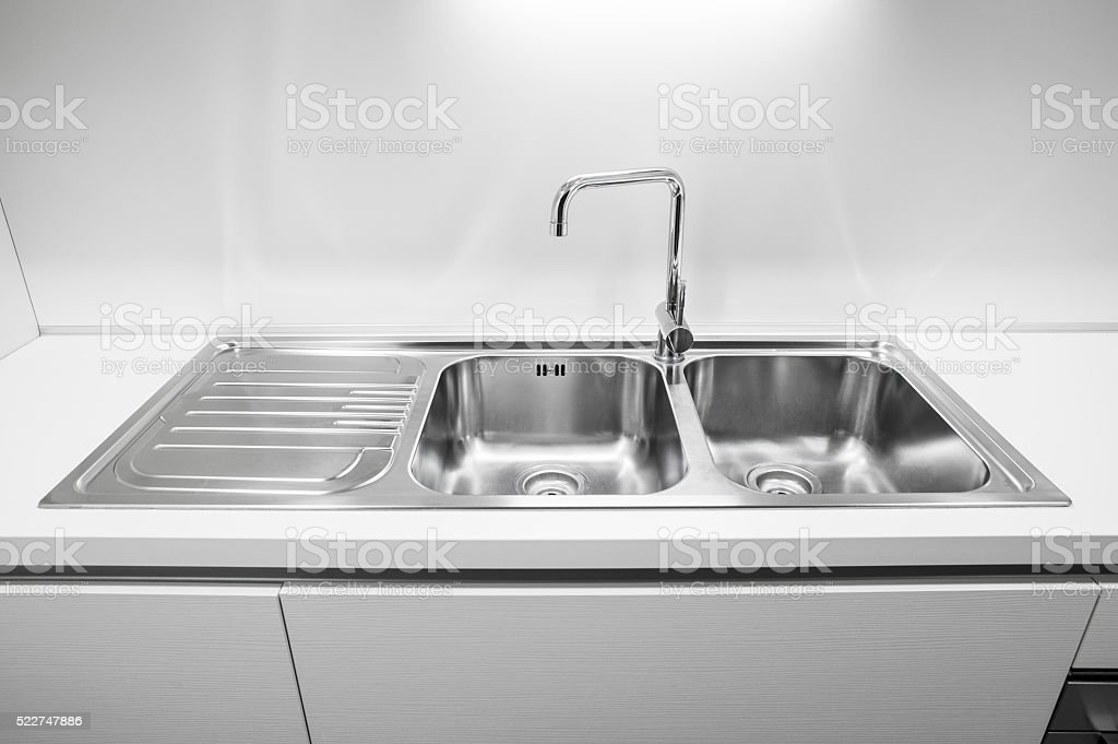 Double bowl stainless steel kitchen sink stock photo