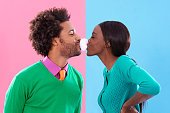 Shot of a cute stylish couple blowing bubbles with gum against a colorful backgroundhttp://195.154.178.81/DATA/i_collage/pi/shoots/783402.jpg