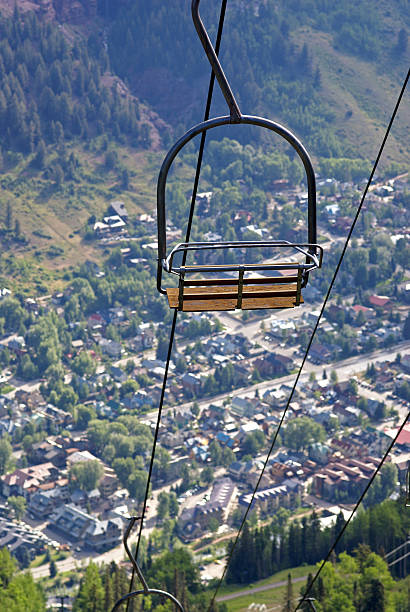 Double Chairlift A double chairlift photographed high above the Colorado town of Telluride in summer. san juan county colorado stock pictures, royalty-free photos & images
