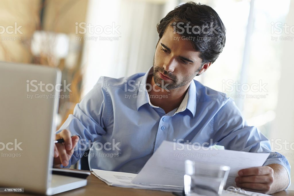 Double checking the numbers... - Royalty-free 20-24 Years Stock Photo