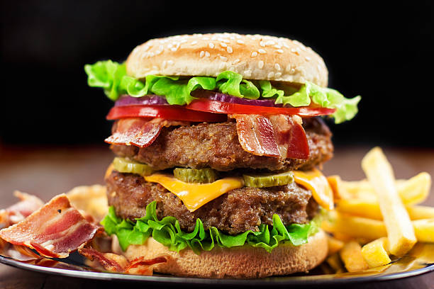 Double Cheeseburger Double Cheeseburger with Bacon bacon cheeseburger stock pictures, royalty-free photos & images
