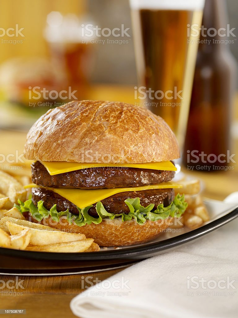 Double Cheeseburger with a Beer royalty-free stock photo