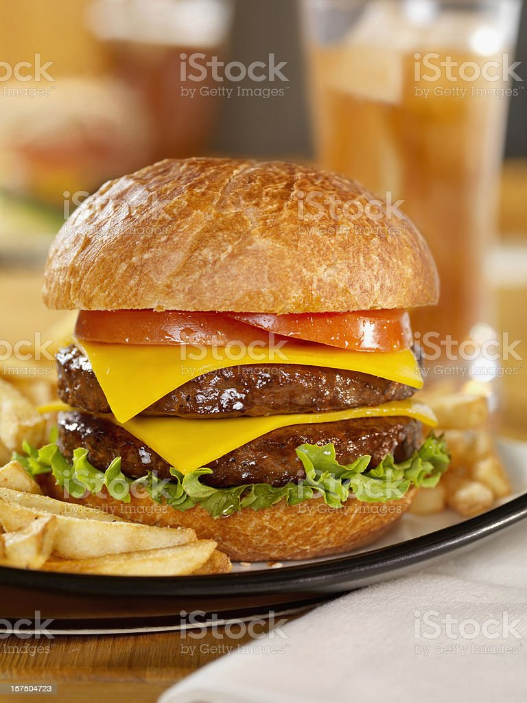 Double Cheeseburger with Iced Tea royalty-free stock photo