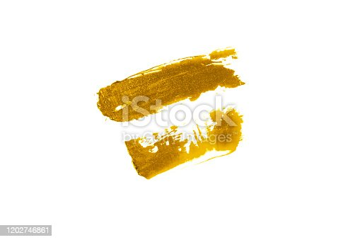 istock Double DAB of the cream is Golden in color. Swatch of lipstick or eye shadow. 1202746861