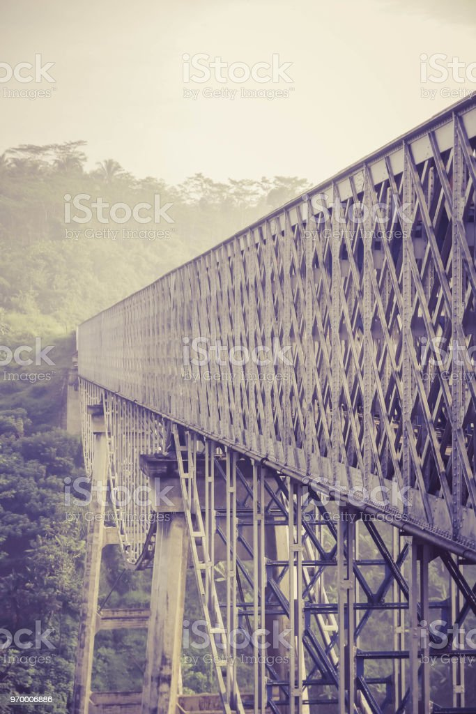 A Double Deck Structure Of Metal Railway Bridge And Car