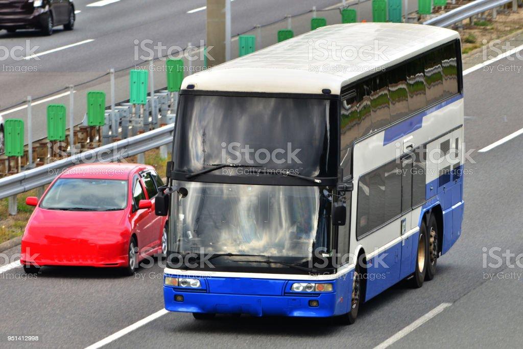 Double decker bus going highway stock photo