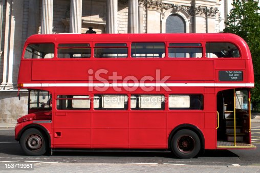 Side view of an empty red Route Master bus in London