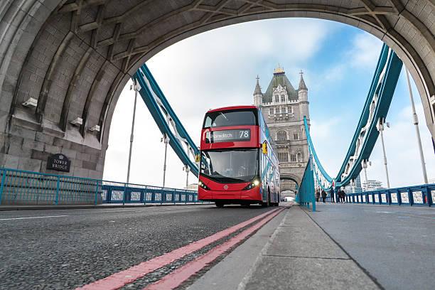 Double Decker Bus on the Tower Bridge of London stock photo