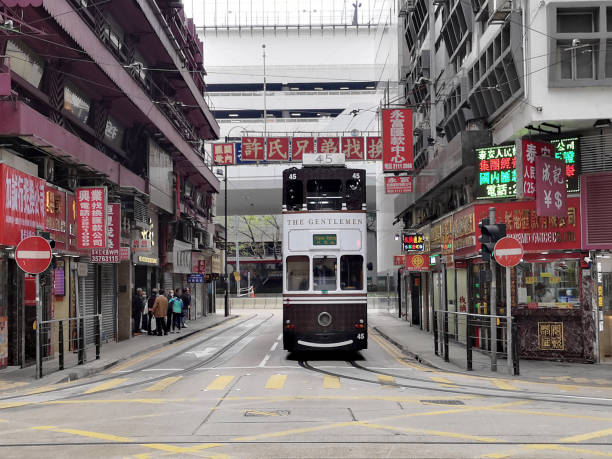 Double Decker Tram riding in Sheung Wan, Hong Kong island stock photo