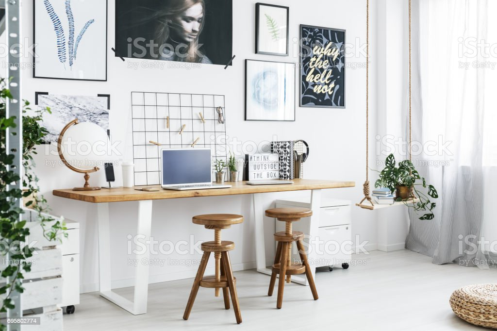 Double desk and two stools in home office stock photo