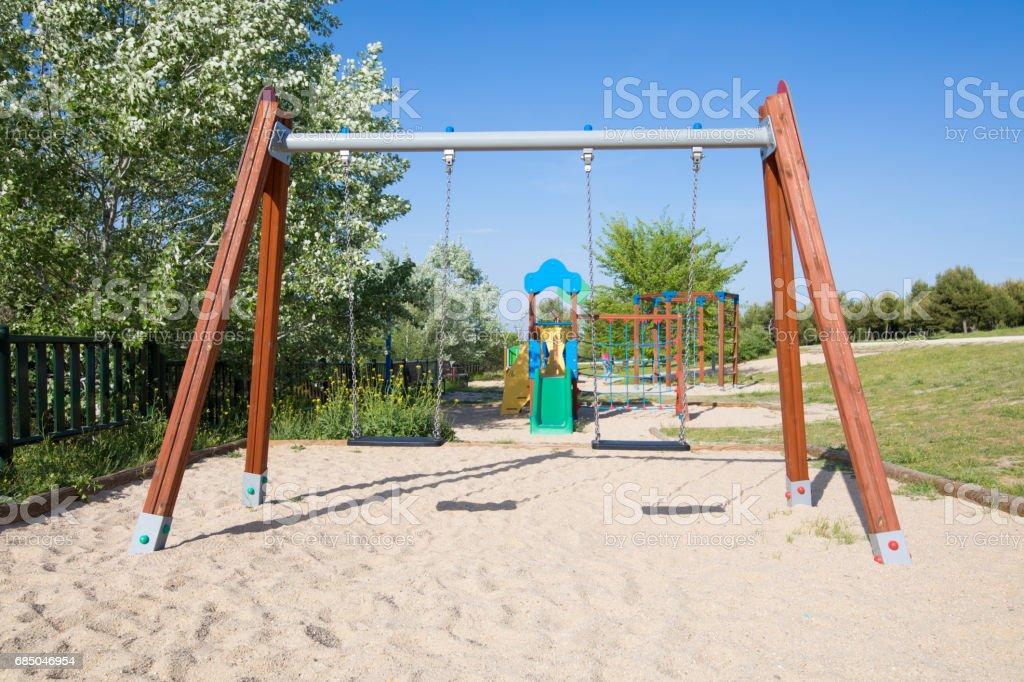 double empty swings in park of Madrid stock photo