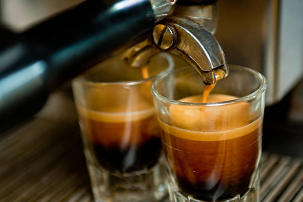 double espresso shot - symmetry stock pictures, royalty-free photos & images