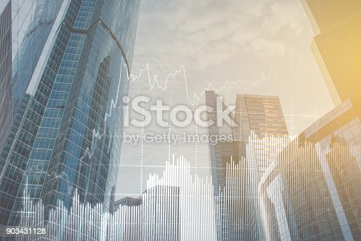 istock Double explosure with business charts and financial district. 903431128