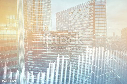 istock Double explosure with business charts and financial district. 903441406