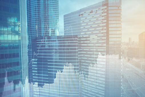 istock Double explosure with business charts and financial district. 931777010