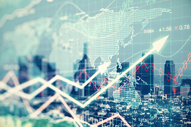 Double explosure with businesss charts and financial district of stock photo